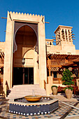 Fountain in front of arabian building with wind tower, Madinat Jumeirah, Dubai, UAE, United Arab Emirates, Middle East, Asia