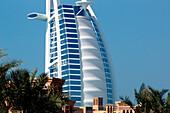 Burj al Arab hotel in front of arab wind towers, Madinat Jumeira, Dubai, UAE, VAE, Vereinigte Arabische Emirate, United Arab Emirates