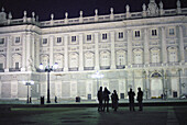 People in front of the illuminated Palacio Real at night, Madrid, Spain, Europe