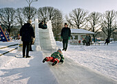 Child on ice slide in Gorki Park, Moscow, Russia