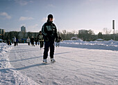 Boy ice skating in Gorki Park, Moscow, Russia