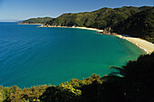 Mutton Cove, beach in a bay in the sunlight, Abel Tasman Coast Track, Abel Tasman National Park, New Zealand, Oceania