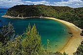 Mutton Cove, beach in a bay in the sunlight, Abel Tasman Coast Track, Abel Tasman National Park, New Zealand, Oceania
