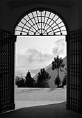 Sight through gate into light, landscape