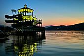 Illuminated lido at lake Woerth, Poertschach, Carinthia, Austria