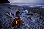 Okarito campfire on beach, NZ, Campfire, Okarito, West Coast, South Island, New Zealand, Lagerfeuer am Strand, Abendlicht, Westkueste, Suedinsel, Neuseeland