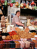 Georgian woman selling dried fruits and nuts, Cheryomushkinsky, Moscow, Russia