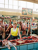 Woman selling meat on market, Moscow, Russia