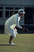 Bowling lady in white uniform, Lawn bowls, popular outdoor sport, in New Zealand