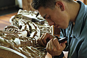 One young man working with wood, Maori wood carving, Rotorua, Maori Arts and Crafts Institute, Whakarewarewa, North Island, New Zealand