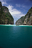 People bathing in a lagoon in front of high rocks, Ko Phi Phi, Thailand
