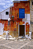 Painters painting a house's facade, Antequera, Andalucia, Spain