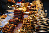 Meat skewers at cookshop at Na Phra Lan old town, Bangkok, Thailand, Asia