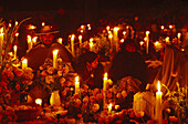 People and candles on a cemetery at night, Day of Death, Tzintzuntzan, Patzcuaro, Michoacan, Mexico, America