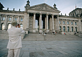 Man photographing the Reichstag, Berlin, Germany