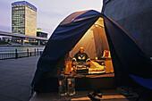 Homeless newcomer in camping tent, Sumida River banks, Tokyo