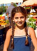 Girl on vegetable market, Peloponnes Greece