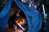 Homeless cooking dinner, living boxes in Ueno Park Basic, communities of temporary shelters, Japan, Ueno Park Basic, Slum, Tokyo, Japan