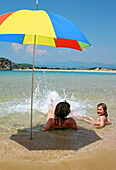 Woman with daughter on the beach, Voidokilia Bay, Peloponnese, Greece