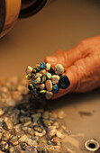 Polishing opal stones, Lightning Ridge, Australien, NSW, Opalschleiferei. Polishing and washing opals The town known as The Ridge is near the Queensland border The opal is Australia's national stone