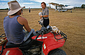 MAn and women talking in front of mail flight, Scenic flight with the post, Cape York Peninsula, Queensland, Australia