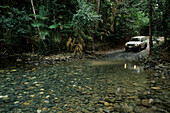 River crossing with 4WD, Rainforest drive, Daintree Nature Reserve Park, Queensland, Australia