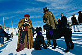 Women in fur coats and dogs, St. Moritz, Grisons, Switzerland, Europe