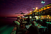 Stokes Hill Wharf with street cafe in the evening, Darwin, Northern Territory, Australia