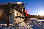 Man animating his dog for a walk, Huberalm, Antholz, Val Pusteria, South Tyrol, Italy