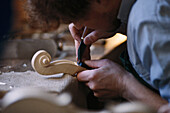 Man carving a fiddle, Mittenwald, Bavaria, Germany
