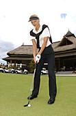 A woman playing Golf, Mauritius