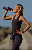 Woman having a drink, a rest from running, jogging, Andalusien, Spain