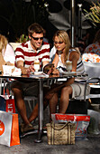 Couple drinking Latte Macchiato in a cafe, shopping break, Cape Town, South Africa