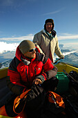 Two people in a fishing boat, Ilulissat, Greenland