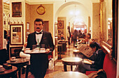 Waiter and guests at Café Greco, Rome, Italy, Europe