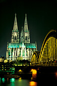 Cologne Cathedral and Hohenzollern bridge at night, Cologne, North Rhine-Westphalia, Germany, Europe