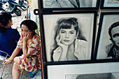 Woman selling drawings in the city, Hanoi, Vietnam, Asia