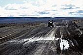 Car on road in lonesome landscape, Rio Mayo, Argentina, South America, America