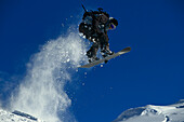 Snowboarder in action, Performing a jump, Valluga, Arlberg, Tyrol, Austria
