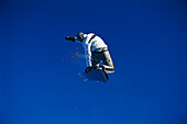 Snowboarder in action, Performing a jump, Kaunertal, Tyrol, Austria