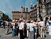 Tourists, Sightseeing, Marienplatz, Munich Bavaria, Germany