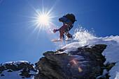 Snowboarder in action, Performing a jump, Hochfuegen, Zillertal, Tyrol, Austria
