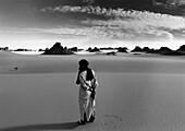 A Tuareg standing in the sand, Tassili n' Ajjer, Sahara, Algeria