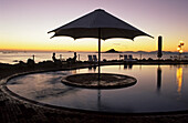 Sunset at pool, Brampton holiday Island resort, Brampton Island, Great Barrier Reef, Queensland, Australia