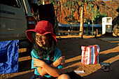 Bushcamping, child with fly net, Australia, bushcamping, child with fly net hat