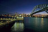 Sydney Harbour Bridge, at sundown. Jeffrey Street Wharf, North Shore, Australia