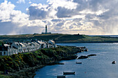 View across Portnahaven towards the lighthouse, Islay, Inner Hebrides, Scotland, Great Britain