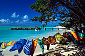 Sandy beach, colorful scarves, sarongs, Pigeon Point, Tobago, West Indies, Caribbean