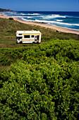 Campmobile near sandy beach, Great Ocean Road, Victoria, Australia