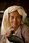 portrait of eldery woman smoking cheerot cigar , Burma, Myanmar